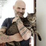 Man holding cat