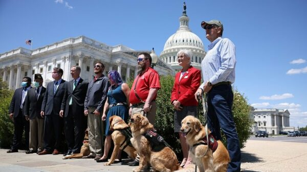 WASHINGTON, DC - MAY 13: Military service dogs and their handlers with K9s for Warriors pose for a photo after press conference for H.R. 1448, Puppies Assisting Wounded Service Members (PAWS) for Veterans Therapy Act outside the U.S. Capitol Building on May 13, 2021 in Washington, DC. The legislation was drafted to help start a program to promote the use of service dogs as a form of therapy for military veterans.