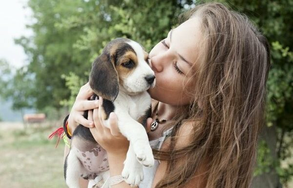 girl holding a puppy
